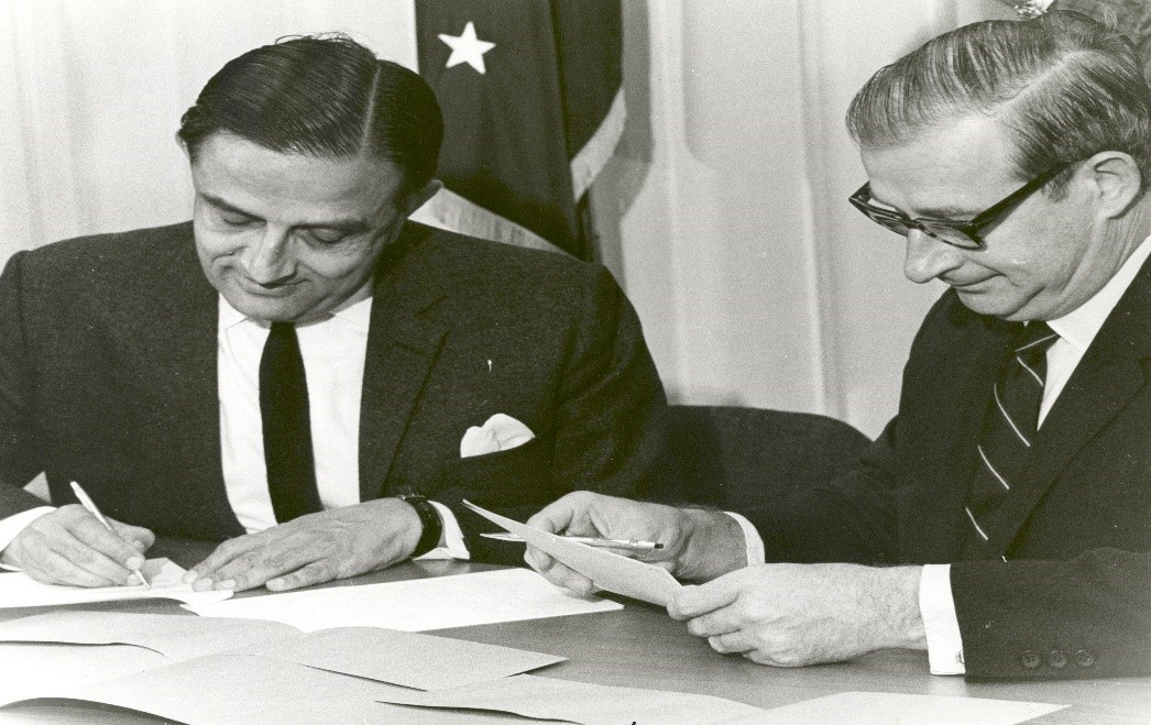 vikram sarabhai and dr paine signing a satellite agreement